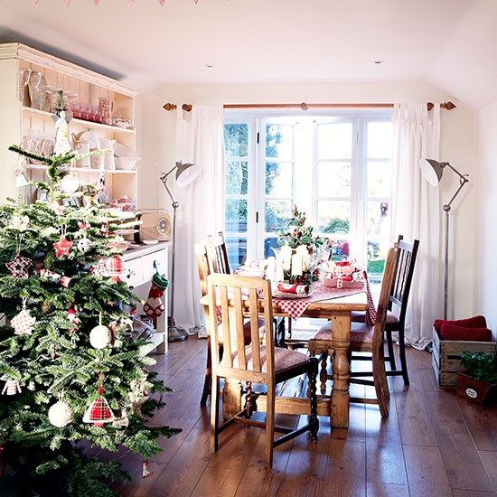 Country Style Dining Room With Christmas Tree Decorating