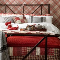 Country bedroom with red tartan wallpaper