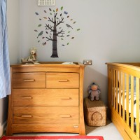 Neutral nursery with wood furniture