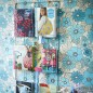 Children's bedroom with wall-mounted magazine organiser and blue retro floral wallpaper