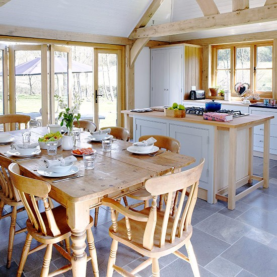 Airy Open-plan Kitchen Space With Farmhouse Furniture