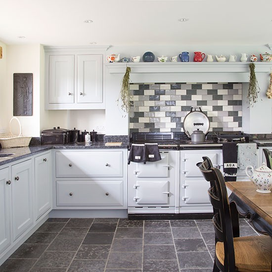 This classic country kitchen is fitted with pale blue painted kitchen