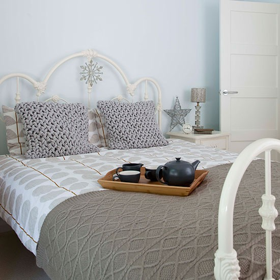pale blue bedroom with taupe bedlinen bedroom decorating style at