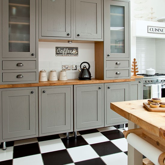 Grey Shaker style kitchen with tiled flooring  Kitchen decorating
