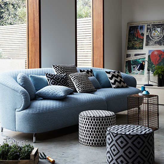 Modern living room with blue sofa and poufs decorating for Blue couch living room