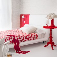 Red and white bedroom with flock wallpaper