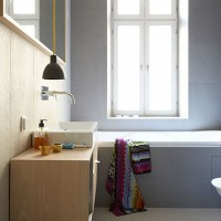 Pale grey streamlined bathroom