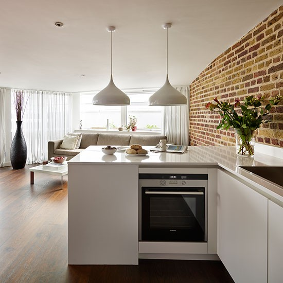 Family Room Kitchen Open Floor Plan White Kitchen: White Open-plan Kitchen With Brick Wall