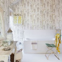 Shabby-chic bathroom with feature wallpaper
