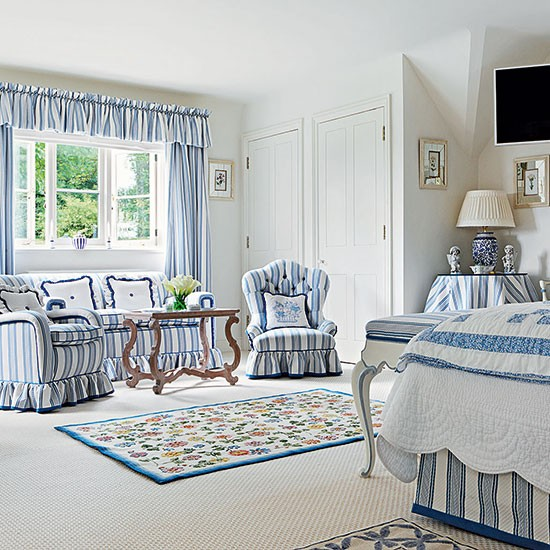 White bedroom with striped living area guest bedroom for Blue guest bedroom ideas