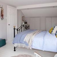 Pale grey and violet bedroom