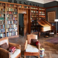 Home office with bookshelves and parquet floor