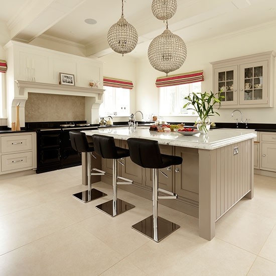 Neutral Family Kitchen With Glamourous Lighting
