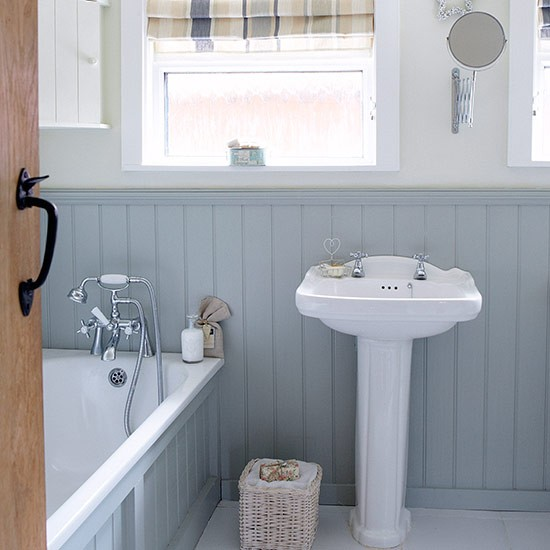 Compact bathroom with blue wall panelling small bathroom for Bathroom decor ideas uk