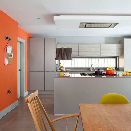 Grey And Orange Kitchen With Retro Furniture