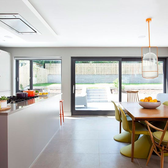 Modern open plan kitchen with orange accents decorating - Kitchen with orange accents ...