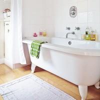 White bathroom with rolltop bath