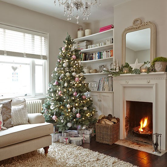 Cream living room with christmas tree decorating for Christmas living room ideas