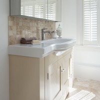 Bathroom with cream and white vanity unit