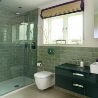 Sage green tiled bathroom
