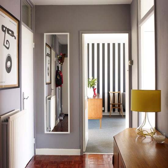 narrow hallway with carefully positioned mirror small