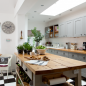 Country kitchen with monochrome checkered floor, island unit and wooden worktops