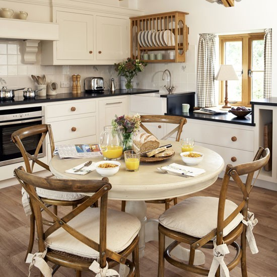 Country-style Family Kitchen With Round Table