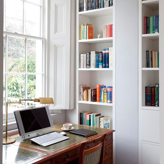 home office with recessed shelving traditional storage