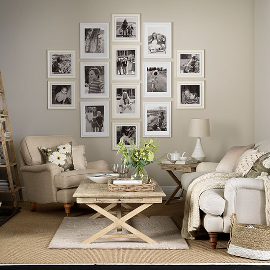 Neutral living room with photo display decorating for Neutral family room ideas