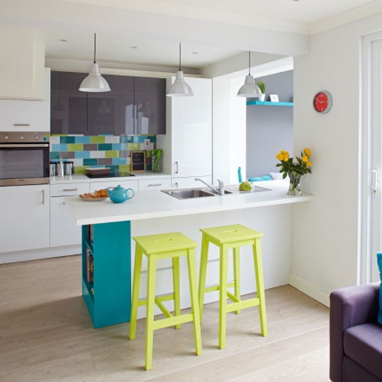 This bright and modern kitchen has a mix of high gloss white units and