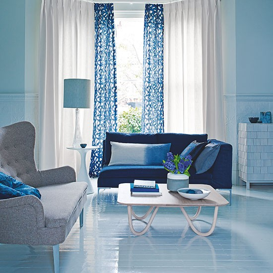 Blue living room with patterned curtains decorating for Living room ideas blue curtains