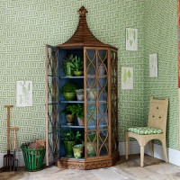 Green hallway with glazed oak cabinet