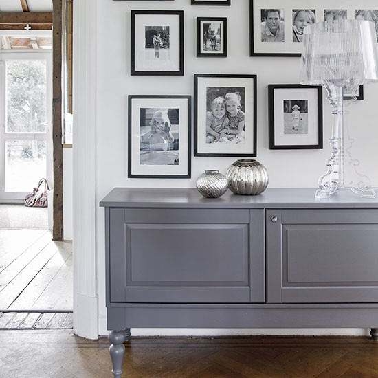 Simple White Hallway With Grey Sideboard Decorating