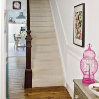 White hallway with eclectic furnishing