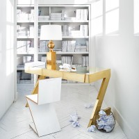 White home office with gold desk