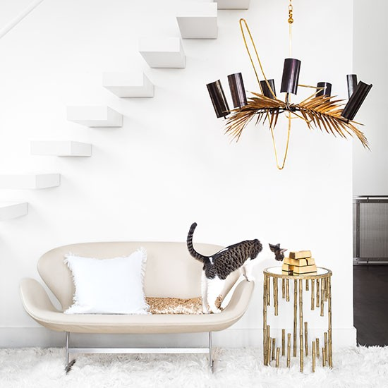 White Living Room With Bronze Chandelier Decorating
