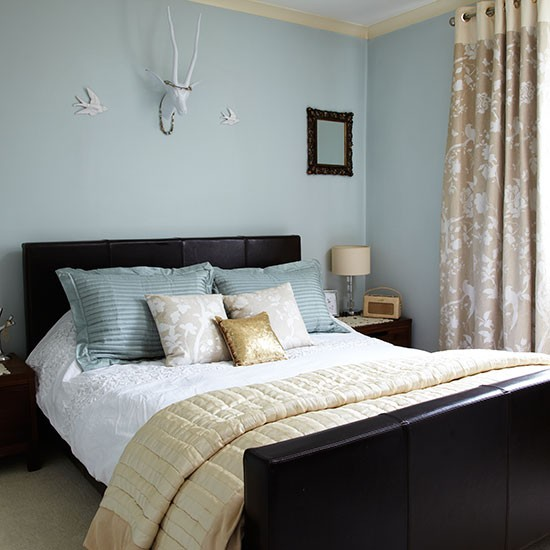 duck egg blue bedroom with gold accents decorating