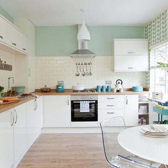 Traditional kitchen with pastel green walls decorating for Kitchen colors with white cabinets with 4 murs papier peints