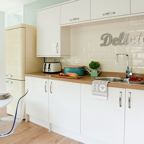 Traditional white kitchen with pastel accents  Kitchen decoating