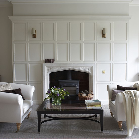Sitting room with white wall panelling Country living