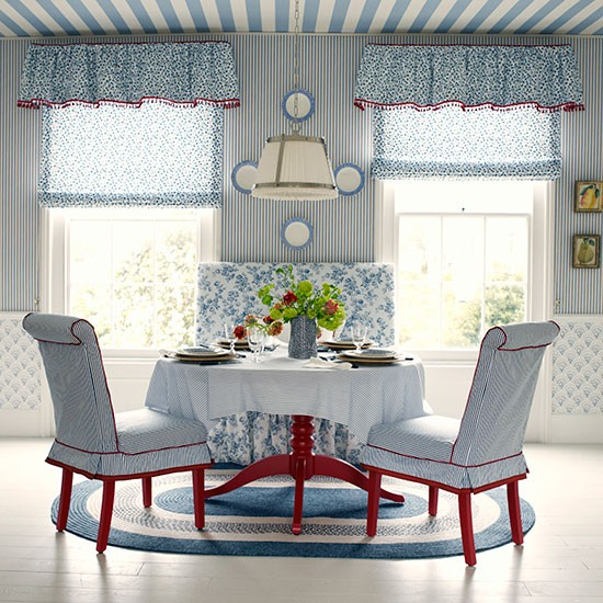 Living Area In Blue Stripes And Florals With A Dash Of Red
