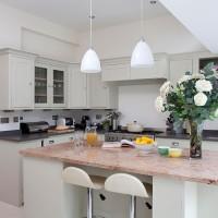 Take a tour around a fresh green modern kitchen
