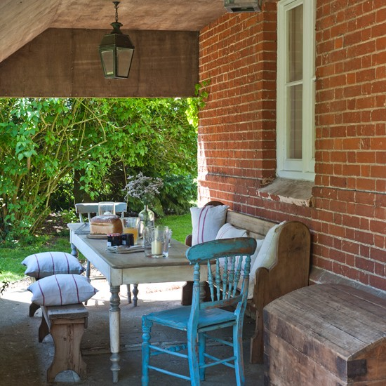 Summer garden with secluded patio seating area summer for Garden designs seating areas