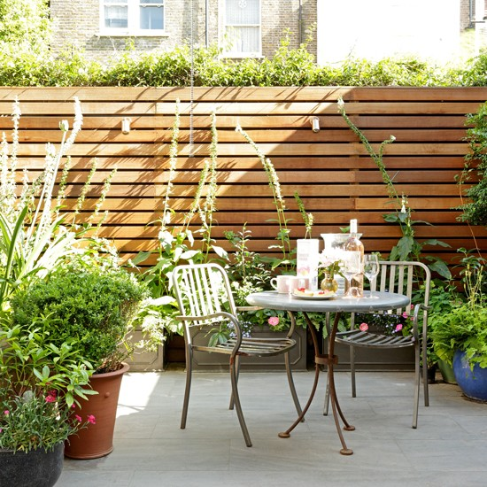 Summer garden with small garden patio and bistro table  : Small garden seating area from www.housetohome.co.uk size 550 x 550 jpeg 135kB