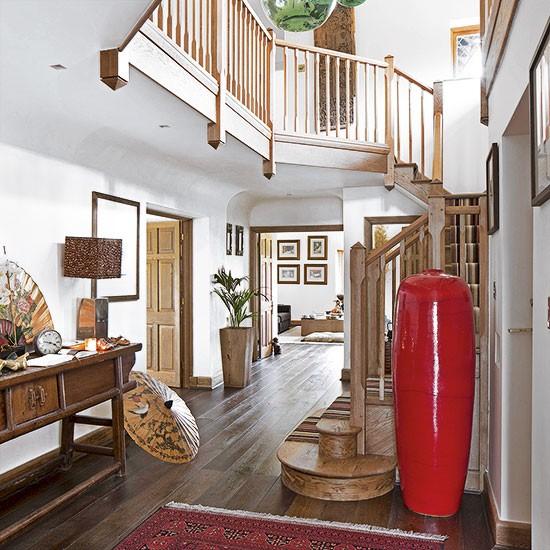 20 Eye Catching Under Stairs Wine Storage Ideas: White Hallway With Wooden Staircase
