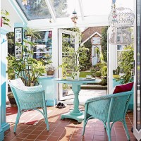 Conservatory with colourful wicker chairs