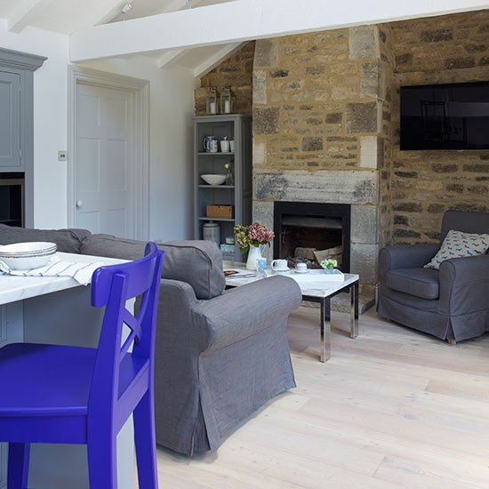 Open plan living room with stone wall decorating for Open plan kitchen ideas uk