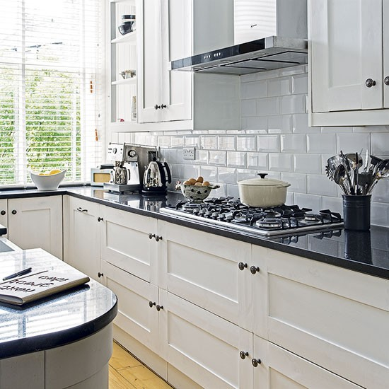 White kitchen with black worktop decorating Kitchen ideas with black and white tiles