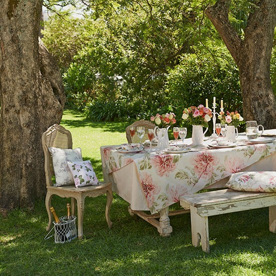 Summer garden with shabby-chic furniture
