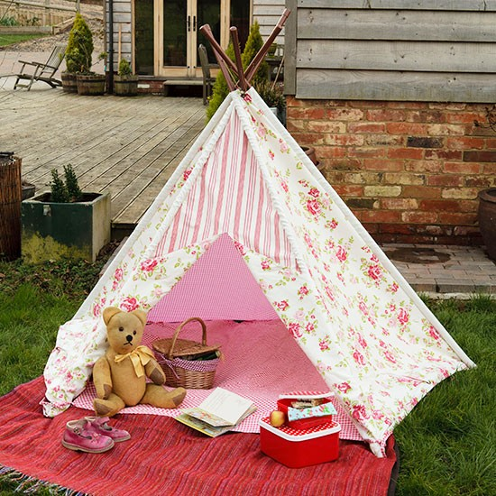 Summer garden with floral children's wigwam